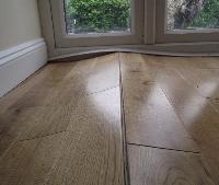 Wood floor being glued in Salisbury