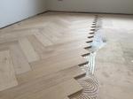 Large engineered Herringbone parquet flooring installed by our team