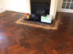 parquet herringbone flooring with cork strip replacement and repairs, sanded and sealed with Bona lacquer