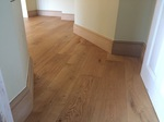 brushed and oiled oak flooring with new oak skirting - Codford