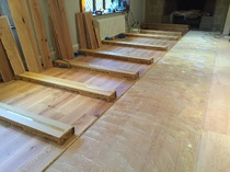 Wood flooring, glued installation.