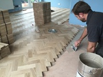 Solid oak Herringbone parquet flooring installed with two block boarder by our craftsman