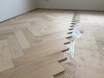 Engineered oak large parquet block wood flooring installed over underfloor heating