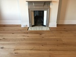 Supply and fit barn oak wood flooring wide oak planks in apartment in Bournemouth