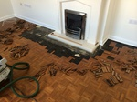 Mosaic parquet repairs to fireplace Shaftesbury