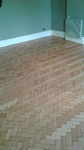 Reclaimed herringbone to match existing parquet pine installed sanded and repaired in Shaftesbury