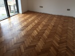 Reclaimed wood flooring pine parquet installed in herringbone style, sanding and finish in Southampton