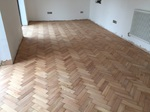 This photo was taken before the lacquer was applied Reclaimed wood flooring pine parquet installed in herringbone style, sanding and finish in Southampton