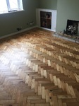 loose pine parquet blocks that needed to be re-stuck before sanding, sanded and finished with Bona Lacquer Ringwood
