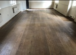 Sanding and sealing of Oak plank flooring in Lymington - before