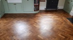 anding and finishing Teak herringbone parquet flooring in Lymington